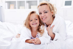 Woman and little girl after bath Stock Images