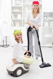 Woman and little girl cleaning the room Stock Images