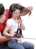 Woman and daughter Little girl dries hair isolated Stock Photo