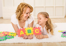 Woman and little girl having fun Stock Images