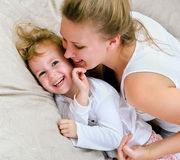 Woman and little girl having fun Stock Photo
