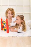 Woman and little girl learning math together Royalty Free Stock Images