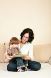 Woman and little girl learning to paint Stock Photo