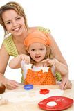 Woman and little girl making cookies Royalty Free Stock Photos