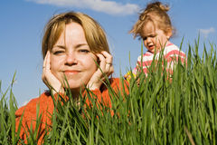 Woman and little girl outdoors Stock Photo