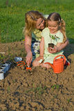 Woman and little girl planting seedlings together Royalty Free Stock Images