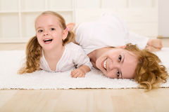 Woman and little girl playing and having fun Stock Photos