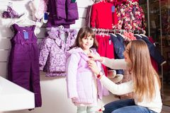Shopping at outerwear supermarket Stock Image