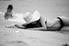 Woman and little girl relaxing on the beach. Thailand stock images