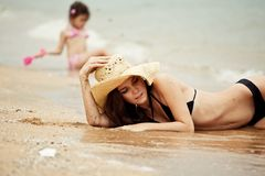 Woman and little girl relaxing on the beach. Thailand stock photography