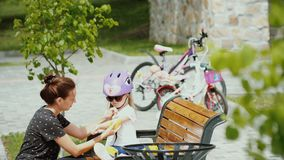 Woman And Little Girl Resting After Bike Ride stock footage