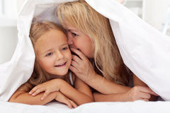 Woman and little girl sharing a secret royalty free stock photos