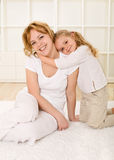 Woman and little girl sharing a tender moment Stock Photos