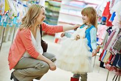 Woman and little girl shopping clothes stock photography