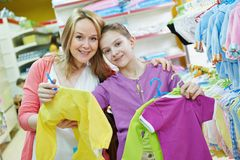 Woman and little girl shopping clothes Stock Photos