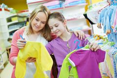 Woman and little girl shopping clothes Stock Photo
