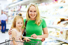 Woman and little girl shopping fruits Royalty Free Stock Photos