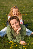 Woman and little girl on the spring meadow Stock Image