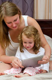 Woman and little girl using tablet pc Stock Photo
