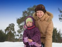 Woman with  little girl in winter Royalty Free Stock Image
