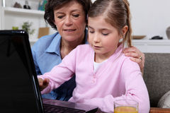 Woman and little girl working stock photos
