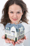 Woman with little house in hand Royalty Free Stock Photos