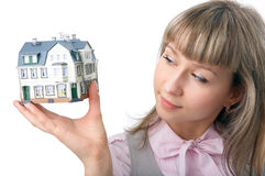 Woman with little house on hand Stock Photos