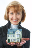 Woman with little house in hand Stock Image