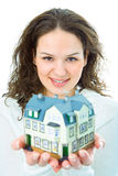 Woman with little house in hand Royalty Free Stock Photography