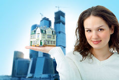 Woman with little house on hand Stock Image