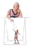 Woman with little marionette. On string at white background Stock Photos
