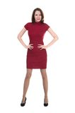 Woman in a little red dress on white background Royalty Free Stock Photo