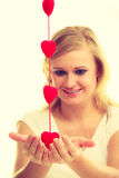 Woman with little red hearts. Charity. Royalty Free Stock Images