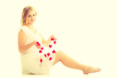 Woman with little red hearts. Charity. Royalty Free Stock Photo