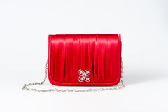 Woman little red purse on white. Background Stock Photo