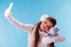 Woman with little snowman taking selfie photo. Stock Images