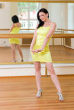 Woman in a little yellow dress Royalty Free Stock Photography