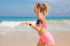 Woman living active lifestyle, running on the beach Stock Photo