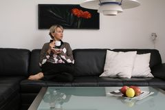 Woman in the living room #1 stock photography