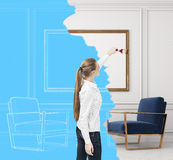 Woman and living room blueprint. Rear view of a blond woman drawing a living room blueprint. Concept of design and creativity. 3d rendering Stock Photos