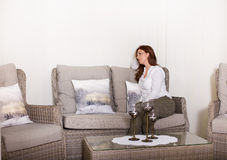 Woman in living room Royalty Free Stock Photos