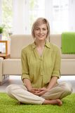 Woman on living room floor Royalty Free Stock Image