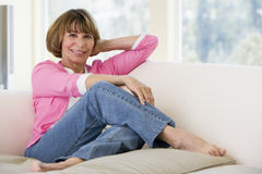 Woman in living room smiling Stock Photo