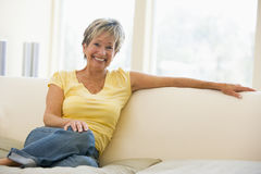 Woman in living room smiling Royalty Free Stock Images