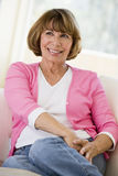 Woman in living room smiling Stock Photography