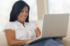 Woman in living room using laptop Royalty Free Stock Photos