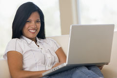 Woman in living room using laptop Stock Image