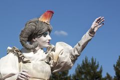 Woman living statue Stock Image