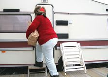 Woman living in a trailer. Middle aged poor woman living in a trailer Royalty Free Stock Image