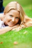 Woman liying on grass Stock Photos